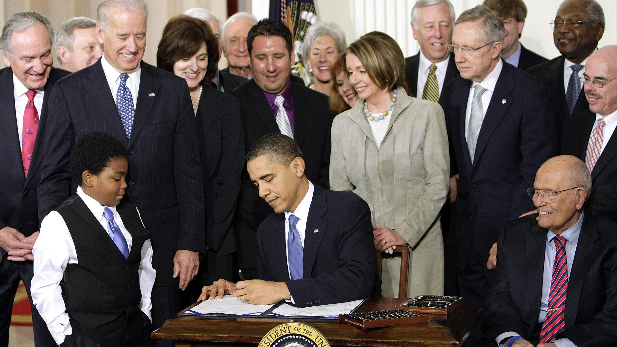 Image result for photos of OBAMA SIGNING ACA
