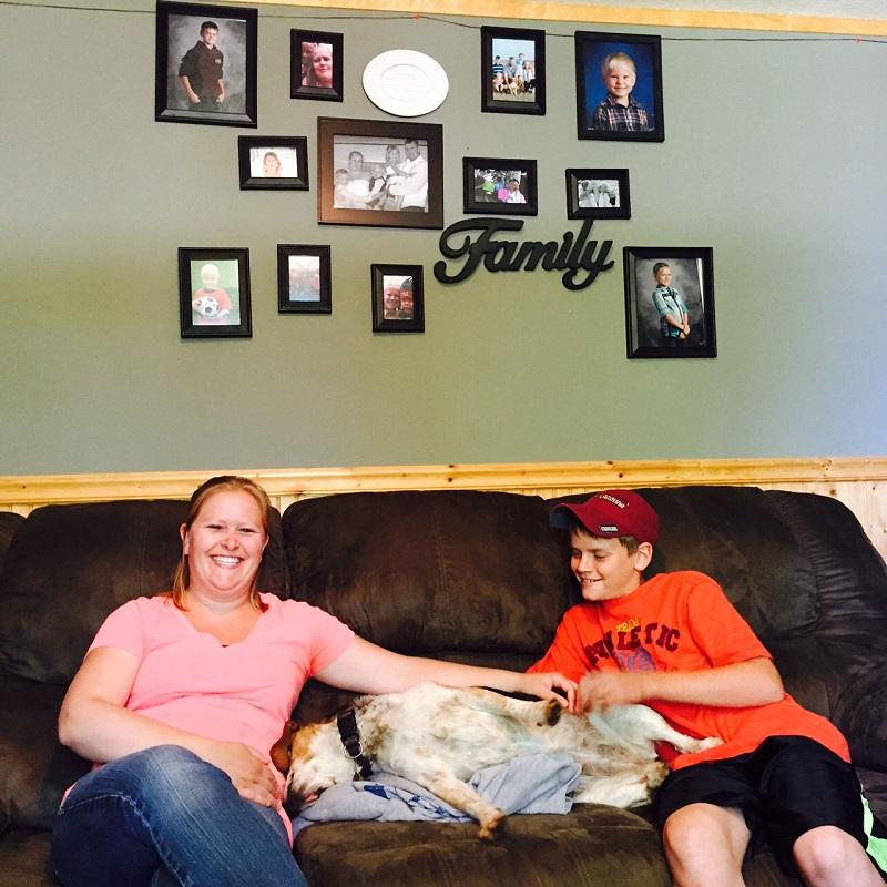 Mandy Pike and her step-son Isaac relax with their dog in their Lyndonville living room. They participated in a drug and alcohol abuse prevention program at Lyndon Town School called PROSPER.