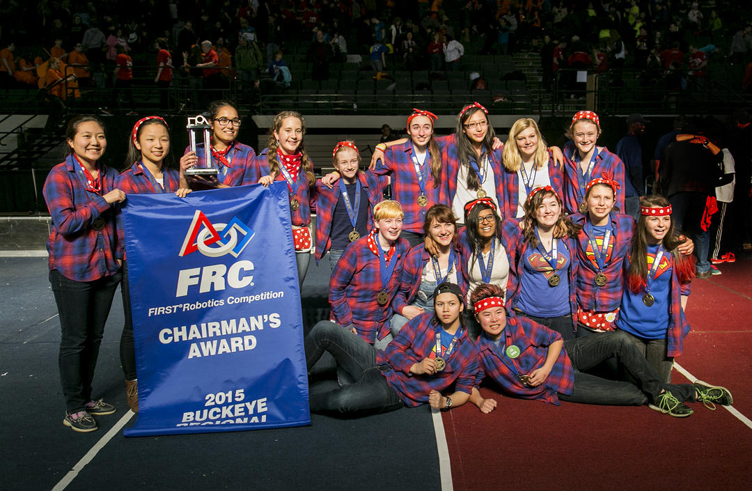 The Girls of Steel pose for a photo after receiving the Chairman's Award at a regional robotics competition in Cleveland. The fifty-member, all-female team will compete at FIRST robotics championship April 22-25 in St. Louis.