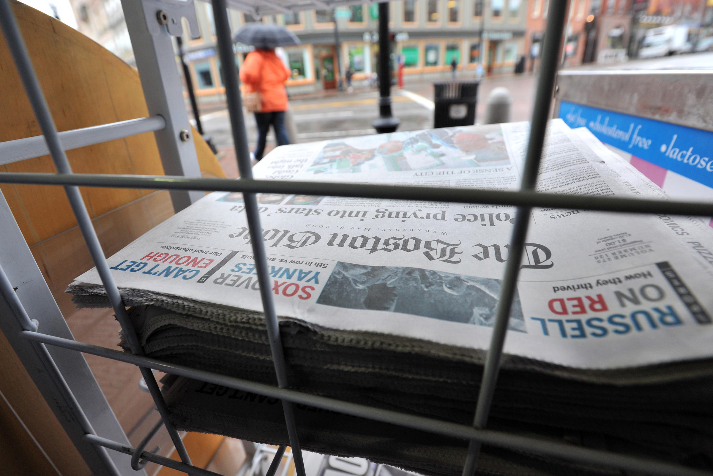 harvard chair for sale chairs folding target poynter journalism ethics allderdice grad duty copies of the boston globe on at a news stand in square cambridge mass wednesday may 6 2009