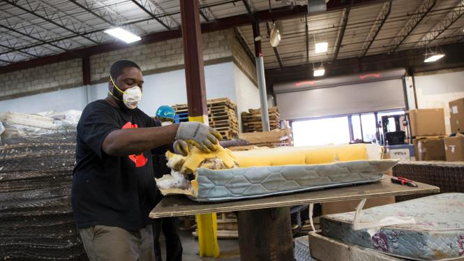 Andre Williams A Worker At Park City Green In Bridgeport Deconstructs Mattress