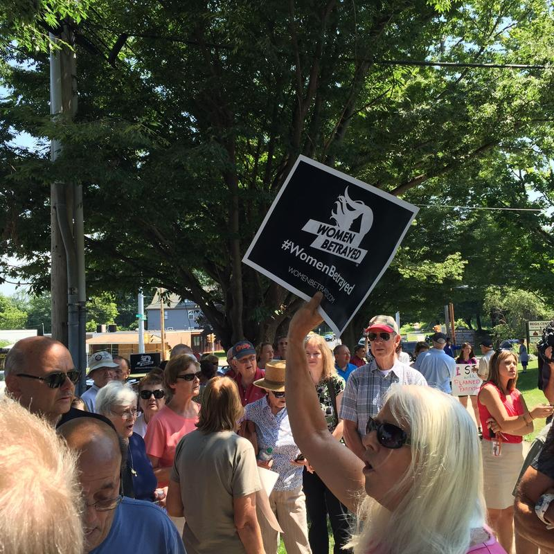 Protesters gathered outside the Syracuse office of Planned Parenthood Tuesday