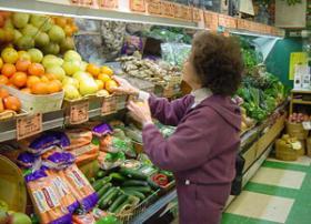 Shopper Choosing Produce In Grocery Store