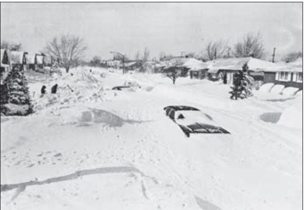 Snow buries a car on Tudor Road in Buffalo suburb of Cheektowaga