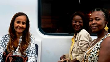 """Got chatting on the train with these women who were on their way to the Olympics fan zone, in the city's port area. In the end they all wanted to take selfies with me for some strange reason, I jus complied. """"We are loving the Olympics. Do you know anyone looking for parking spaces? I''m renting out my garage."""""""