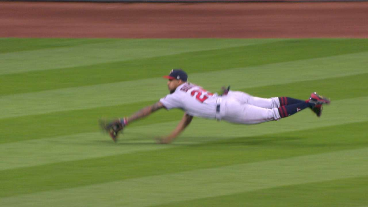 Buxton's diving grab in center