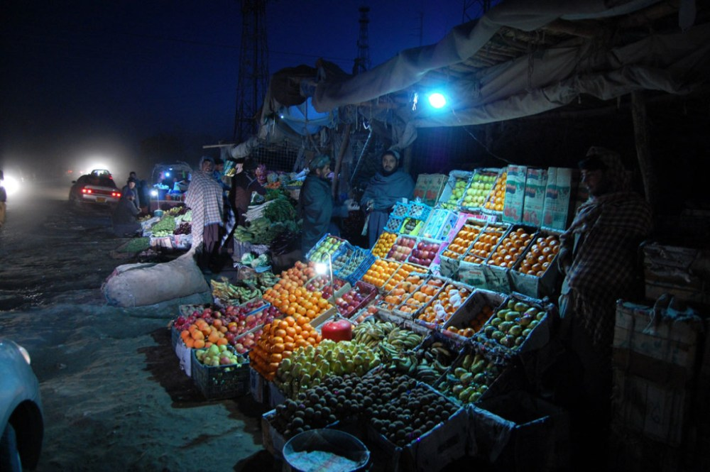 An Afghan refugee vendor waiting for customers at his stall of fruit on the road side at Pakistani border town Chaman, along with Afghanistan border on Wednesday, January 14, 2015. Photo by Matiullah Achakzai.