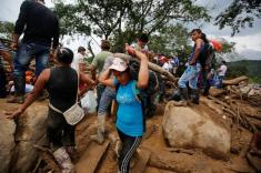 People recover their belongings after flooding and mudslides caused by heavy rains, leading several rivers to overflow, pushing sediment and rocks into buildings and roads, in Mocoa, Colombia April 2, 2017. REUTERS/Jaime Saldarriaga