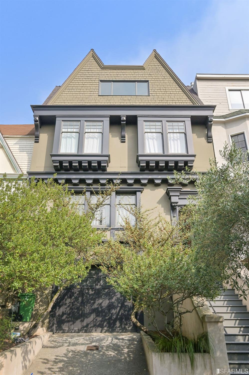 This 3 story Edwardian gem has restored original details, and a spacious floor plan perfect for family, entertaining, and working from home. Substantially renovated; including cost reducing solar panels and upgraded foundation.  Upon entering the entry hall, you are greeted with views of the rear garden. The gracious kitchen features Carrara marble counters, large 7' island, top of the line chef's fixtures, and ample storage. Completing the main level is the living room, half bath, bonus room (home office), and dining room with fireplace. Up the grand staircase, a broad hall leads to two bright bedrooms sharing a full bath, and a luxe owners' suite. The owners bathroom has clawfoot tub, marble tiled floors and shower room. 2 walk-in closets and additional closet storage. The top floor bedrooms offer flexible space and refreshing views.  The home also has a massive garage with storage, laundry room, and a beautifully landscaped patio. Prime location near amenities and parks.