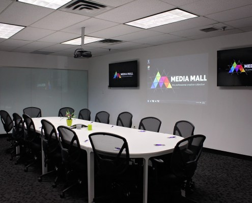 Downstairs meeting room with full boardroom table at Media Mall Ottawa