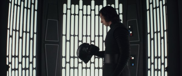 Kylo Ren holds his helmet in Star Wars: The Last Jedi.