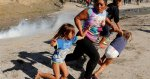 Activists, Politicians React With Horror At Border Scenes Of Tear-Gassed Children