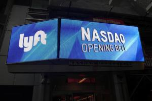 S&P 500 climbs to its biggest quarterly gain in a decade; Lyft jumps