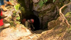 One of the five men trapped in a Virginia cave is out. Rescuers have gone back in to help the remaining four