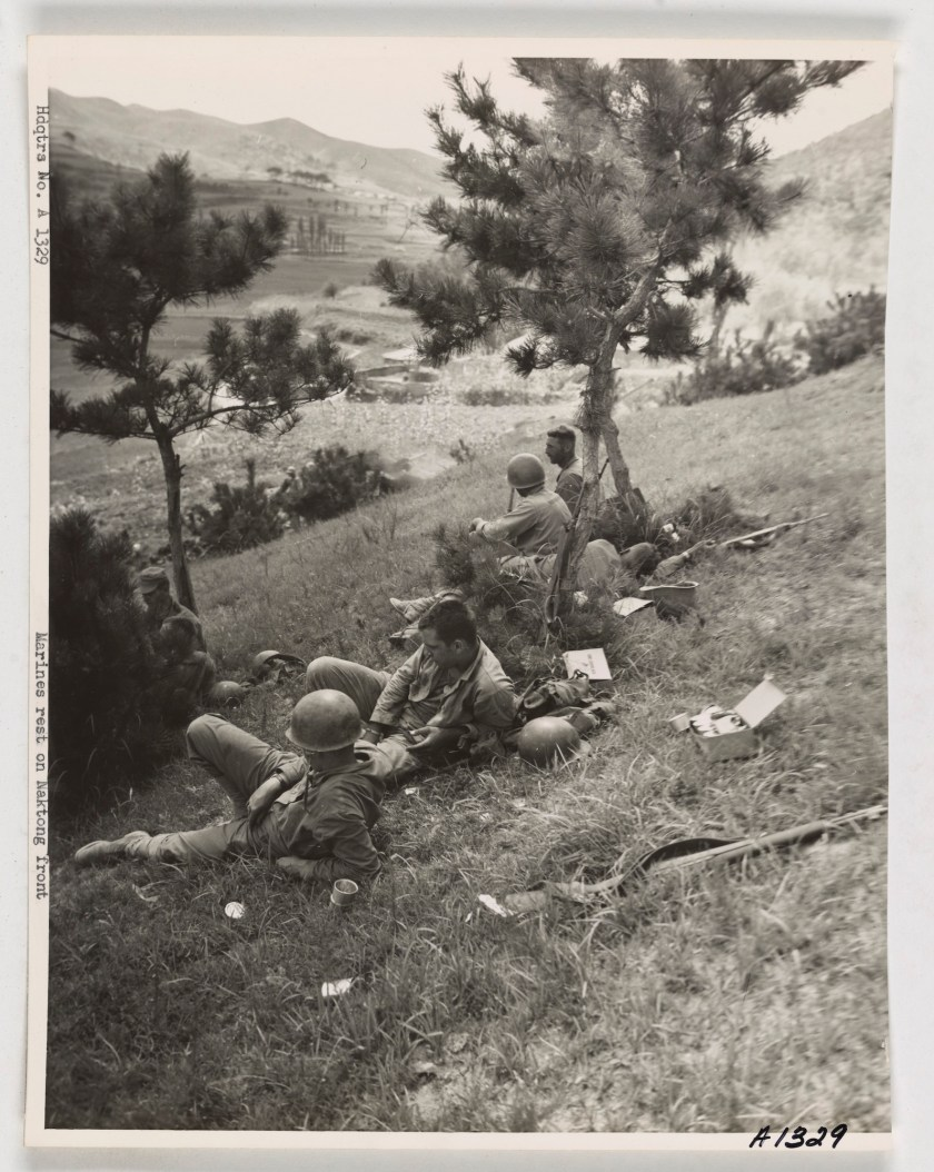 Korean War: Weary marines rest in scanty shade.