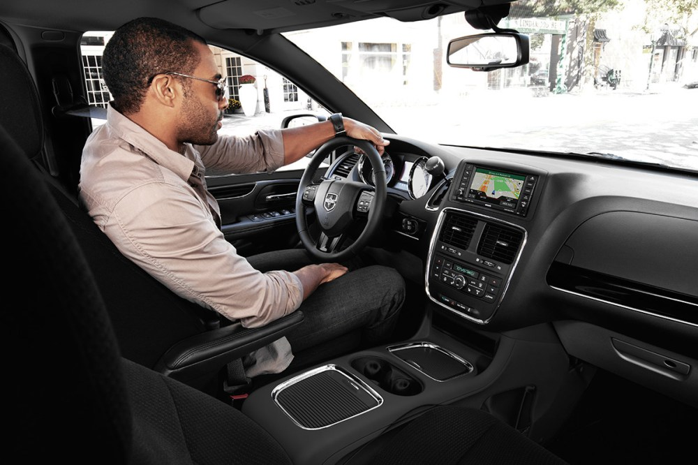 medium resolution of 2019 dodge grand caravan interior view of man driving using navigation