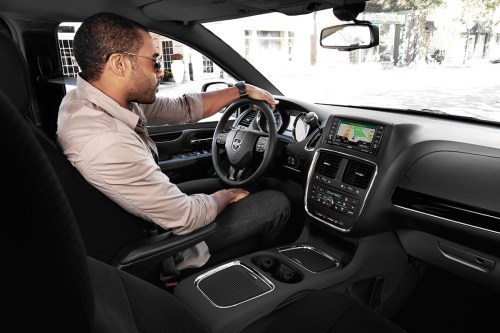 small resolution of 2019 dodge grand caravan interior view of man driving using navigation