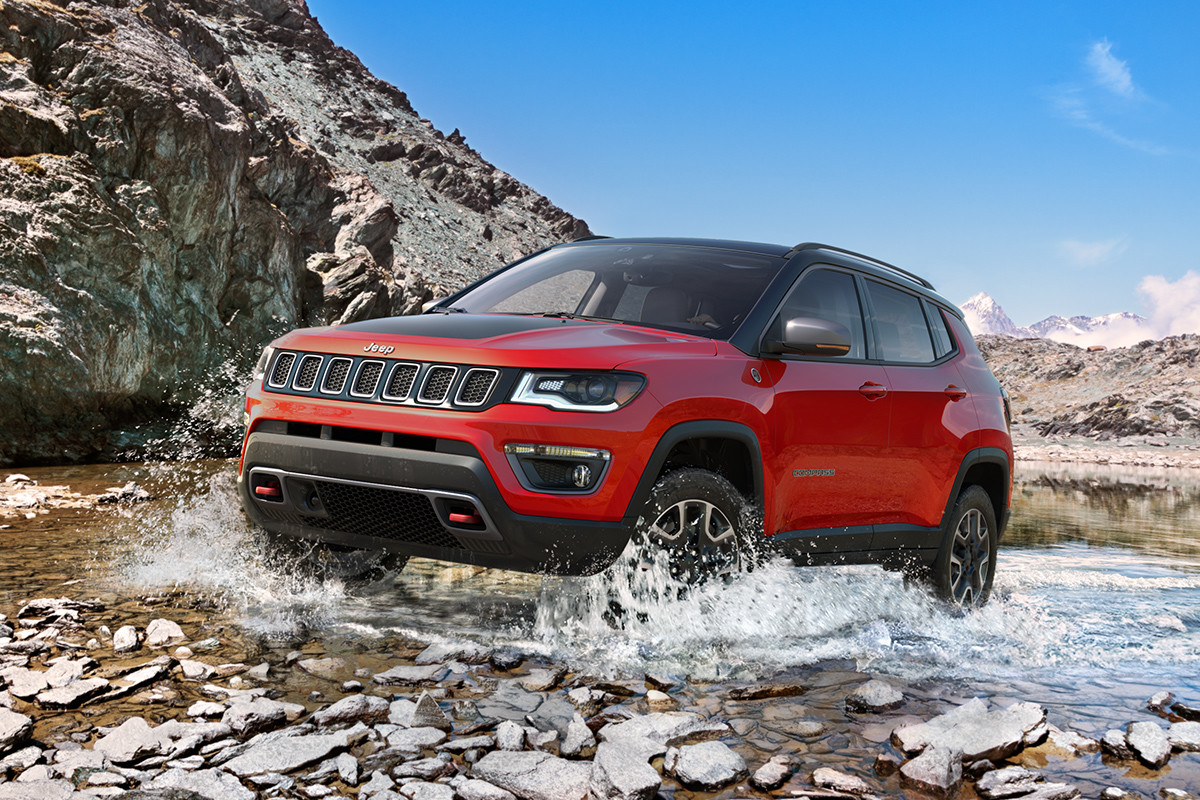 hight resolution of 2019 jeep compass off roading in a forest