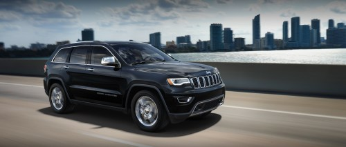 small resolution of  black 2019 jeep grand cherokee speeding through the roads in front of a city skyline