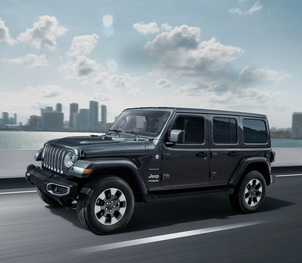medium resolution of 2019 jeep wrangler on highway shown in dark grey