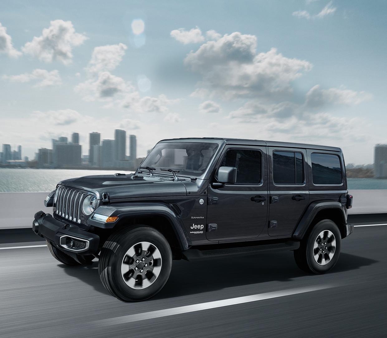 hight resolution of 2019 jeep wrangler on highway shown in dark grey
