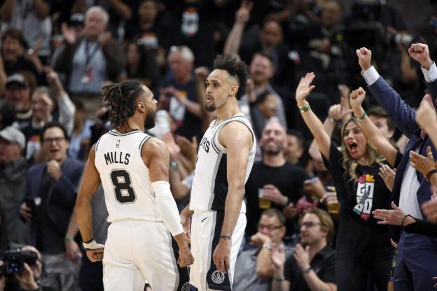 Basket - NBA - Derrick White (à droite) a inscrit 36 points face à Denver jeudi soir. (Reuters)