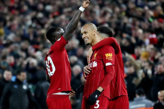 Soccer Soccer - Premier League - Liverpool v Manchester City - Anfield, Liverpool, Britain - November 10, 2019 Liverpool's Fabinho celebrates scoring their first goal with Sadio Mane and Roberto Firmino Action Images via Reuters / Carl Recine EDITORIAL USE ONLY. No use with unauthorized audio, video, data, fixture lists, club / league logos gold
