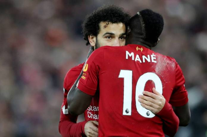 Soccer Soccer - Premier League - Liverpool vs Manchester City - Anfield, Liverpool, Britain - November 10, 2019 Liverpool's Mohamed Salah and Sadio Mane celebrate after Fabinho scores their first goal Action Images via Reuters / Carl Recine EDITORIAL USE ONLY. No use with unauthorized audio, video, data, fixture lists, club / league logos gold