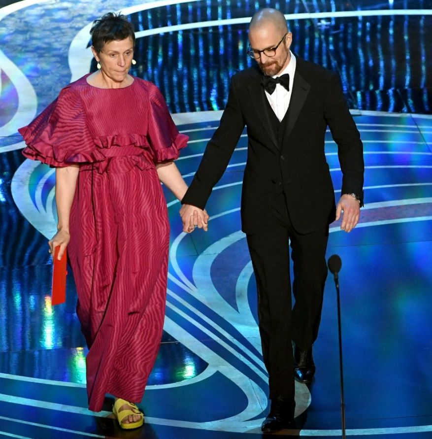 HOLLYWOOD, CALIFORNIA - FEBRUARY 24: (L-R) Frances McDormand and Sam Rockwell speak onstage during the 91st Annual Academy Awards at Dolby Theatre on February 24, 2019 in Hollywood, California.   Kevin Winter/Getty Images/AFP