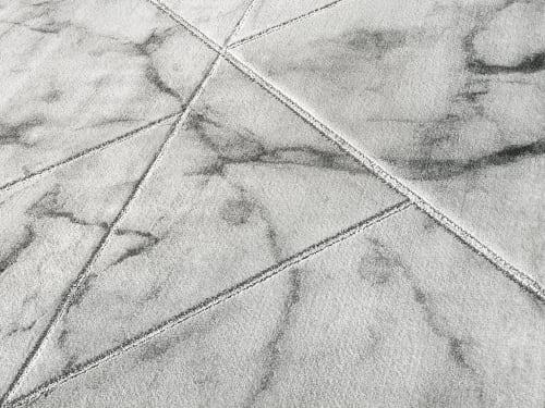 tapis salon en laine artificielle effet marbre et touche dore 160x230 maisons du monde