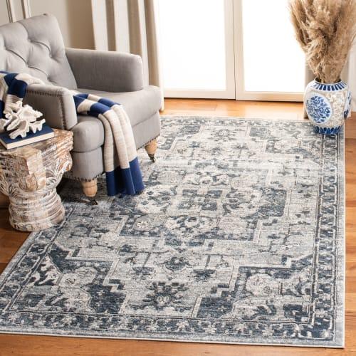 tapis de salon traditionnel chic bleu marine et ivoire 91x152 maisons du monde