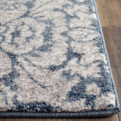 tapis de salon d inspiration vintage bleu et beige 200x300 maisons du monde