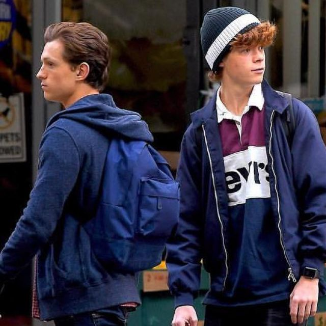 blue backpack worn by