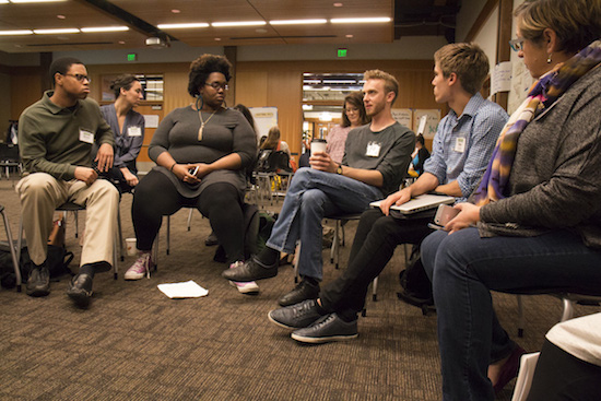 Conference participants join Sydette Harry for a breakout session at Experience Engagement. Photo by Emmalee McDonald.