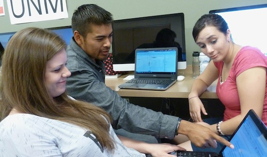UNM students Tanya Prather, Derrick Toledo and Rachael Rivera edit a story in an advanced multimedia journalism class. The students will submit the story to the New Mexico News Port, which makes it available to professional partners.