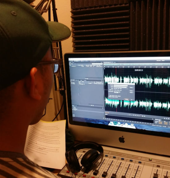 Photo by Holly Wise VoiceBox Media intern Reynaldo Leanos Jr. edits an audio file for a story he is producing about immigration in Texas.