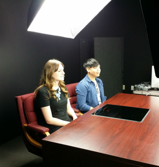 Photo by Holly Wise Two VoiceBox Media interns, Kristen Smith and Roy Quismundo, are interviewed for a promotional video for VBM.
