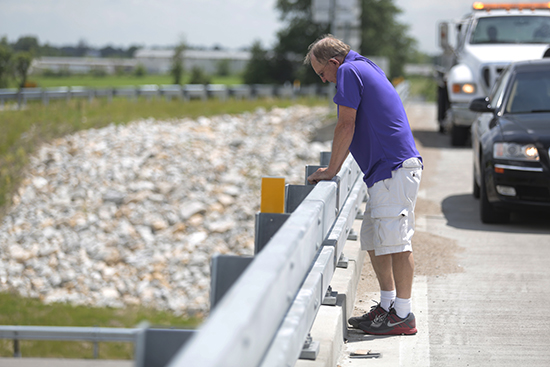 The driver of an SUV that struck and killed a motorcyclist stares down from the Route Z bridge over I-70 near Columbia after learning the cyclist died from her injuries. The SUV driver was not found to be at fault in the crash. Photo by Shannon Elliott/Missourian.