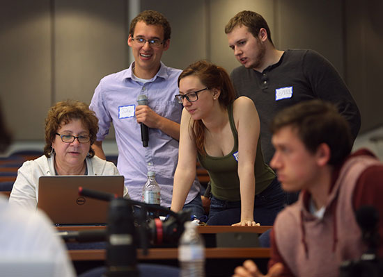 Jan Leach, left, an associate professor of journalism at Kent State, gets help with some D3.js coding from HacKSU members Jake Tobin, Robin Bonatesta and Paul Dilyard. HacKSU is Kent State's student hacker group. Photo by Bruce Zake