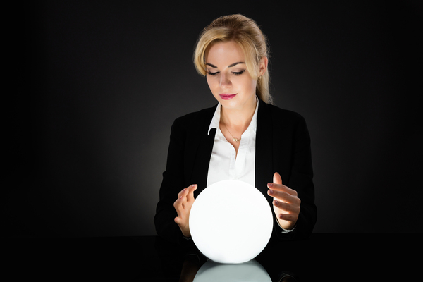 A beautiful woman staring into a lighted ball.
