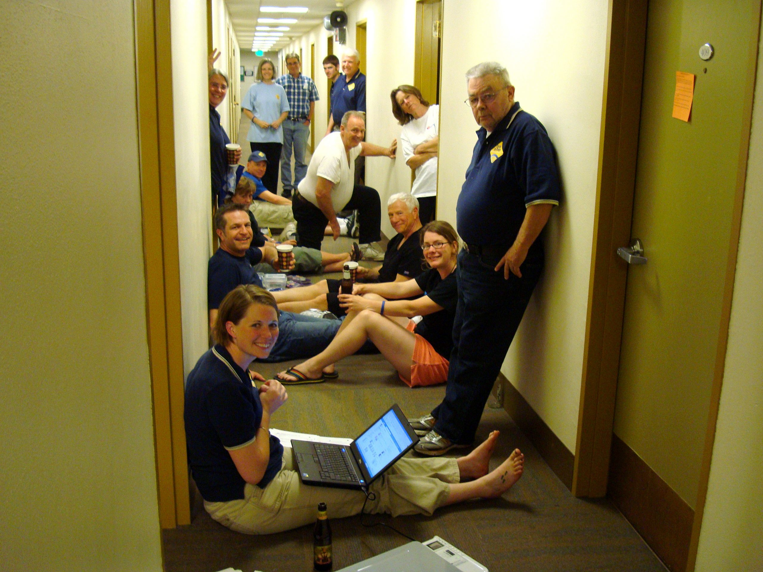 C4C gathers in the dorm hallway.