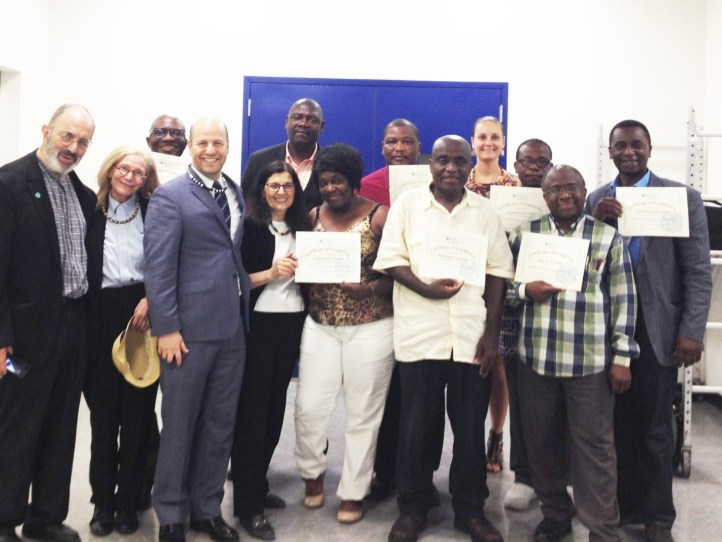 At the conclusion of the final training session, the MBBI-NY – CUNY team awarded attendees with Certificates of Completion, and members of ULAA gave Liberian necklaces and dashikis to the trainers.
