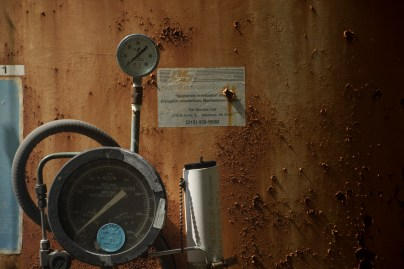 The readout dial of a rusted tank.