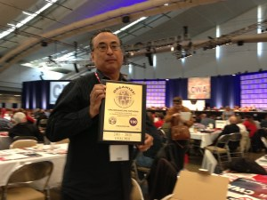 Mike Cabanatuan, former Guild president, holds CWA organizing award. Photo by Media Guild staff 2013.