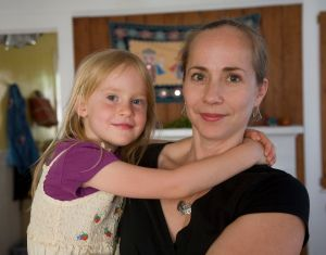 Katy Van Sant and her daughter Lyla in their home in Oakland. Van Sant is advocating for a raise for court interpreters. Photo by David Bacon.