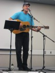 Paul Burton, editor of San Mateo Labor Council bulletin, plays guitar at a union meeting. Photo courtesy Paul Burton 2014.