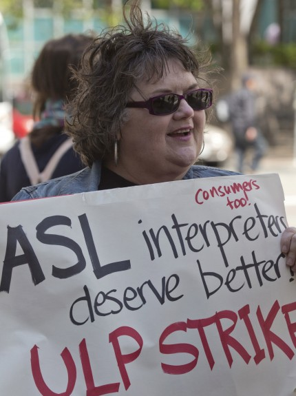 Carol Day turned out at Purple Communications in Oakland in support of ASLIU members who were on a one-day ULP strike.  Photo by David Bacon 2014.