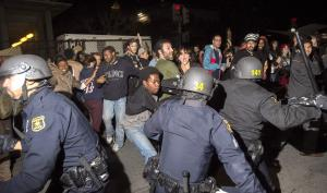 Protesters and police clashed Saturday during demonstrations against police brutality in the Mike Brown and Eric Garner cases. Several members of the press were assaulted by police officers wielding batons.  Photo courtesy NBC news/2014.