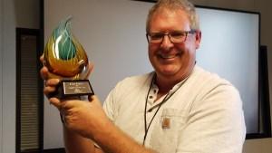 Kent Porter, Santa Rosa Press Democrat photographer, displays his Employee of the Year award. (Photo by Derek Moore 2016)