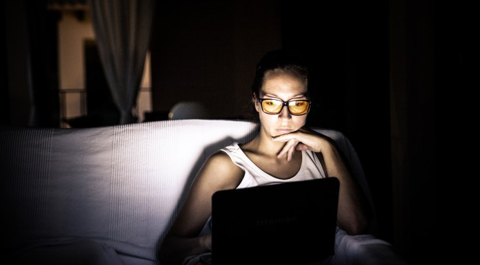 Girl with laptop at night